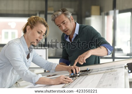 Engineers working on design in office