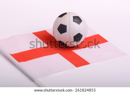 England flag with old championship soccer ball - stock photo