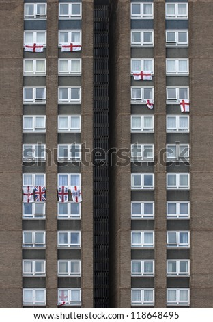 England Flags hanging out of Flat Windows - stock photo