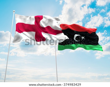 England & Libya Flags are waving in the sky - stock photo