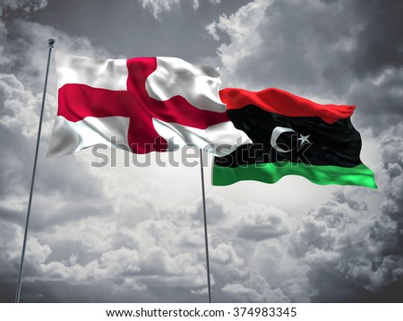 England & Libya Flags are waving in the sky with dark clouds - stock photo