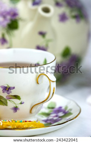 English afternoon tea with sweet and decored cookies - stock photo