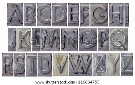 English alphabet - a collage of 26 isolated letters in grunge letterpress metal type, scratched and stained by ink - stock photo