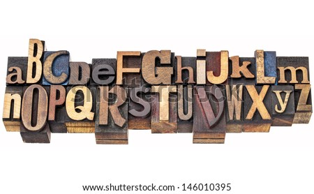 English alphabet abstract in antique wood letterpress printing blocks of different sizes and styles, two rows isolated on white - stock photo