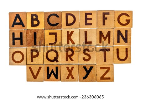 English alphabet capital letters on wooden blocks isolated over white - stock photo