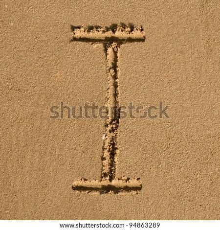 English alphabet in the sand - stock photo