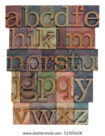English alphabet (lower case) in vintage wooden letterpress type, stained by  inks of different colors, flipped horizontally, isolated on white - stock photo