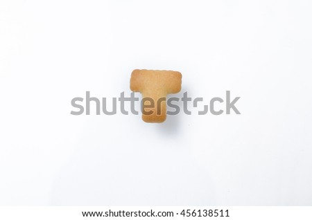 English alphabet made from bread. Letters of the British alphabet made of gingerbread. The letter T - stock photo