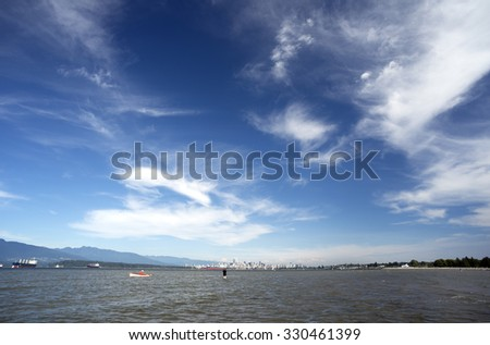 English Bay, shallow warm water and Vancouver in the back, British Columbia, Canada - stock photo
