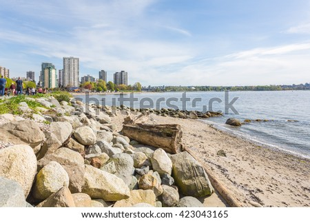 English bay view from Stanley park seawall with rocks on the shore. - stock photo
