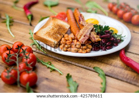 English breakfast - eggs, sausages with beans - stock photo