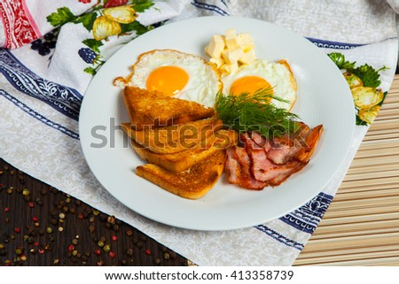 English breakfast. healthy breakfast with eggs, bacon, and toast bread.