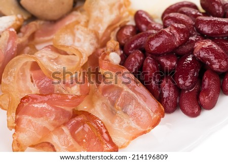 English breakfast with fried bacon beans and fresh salad. Haute cuisine. - stock photo