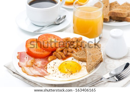 English breakfast with fried eggs, bacon, beans, coffee and juice, isolated - stock photo