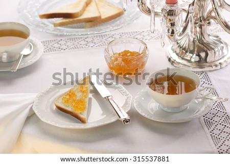 English breakfast with tea and and toast - stock photo