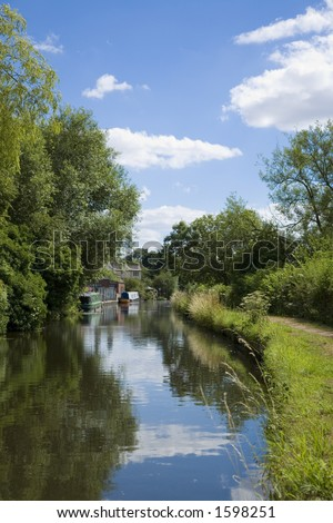 English canal with river boats on it