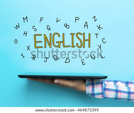 English concept with a tablet on blue background