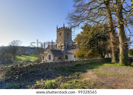 English Cotswold church with copy-space - stock photo