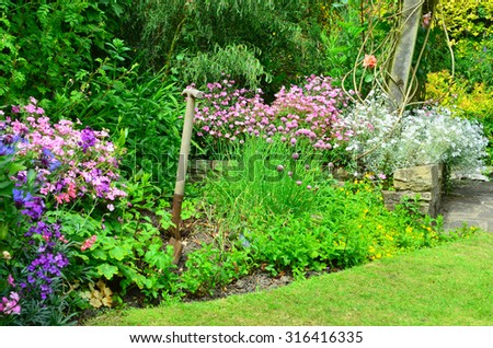 English country garden at the end of summer going into Autumn - stock photo