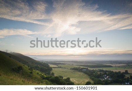 English countryside landscape during late Summer afternoon with dramatic sky and lighting - stock photo