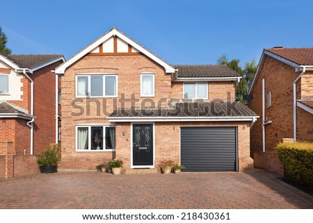 English detached house with garage - stock photo