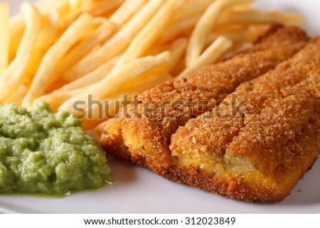 English food: fried fish fillets and chips and pea puree macro. horizontal - stock photo