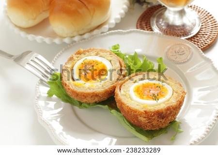 English food, Scotch egg and butter roll bread for gourmet brunch food - stock photo