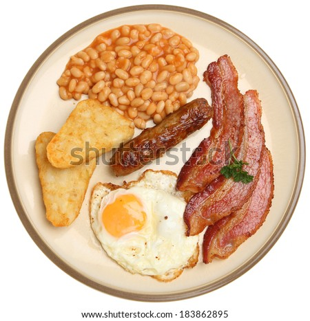 English fried breakfast with egg, bacon, sausage, hash browns and baked beans. - stock photo