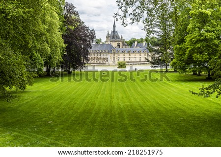 English Garden (Jardin Anglais, 1817). Famous Chateau de Chantilly (Chantilly Castle, 1560) - historic chateau, town of Chantilly, Oise, Picardie, France.