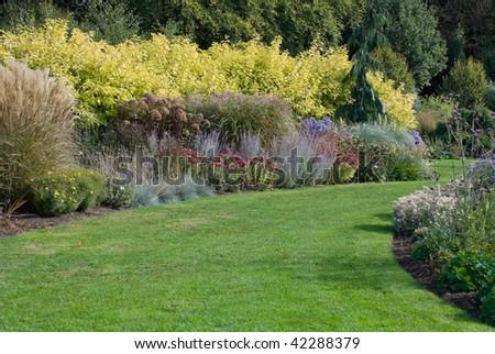 English garden path, September - stock photo