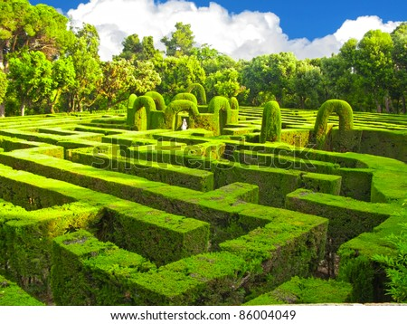 English green labyrinth with a cloudy sky - stock photo