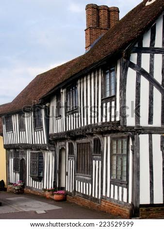 English half-timbered black and white Tudor houses from Lavenham, Suffolk England - stock photo