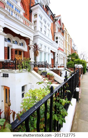 English Homes.Row of Typical English Terraced Houses at London. - stock photo