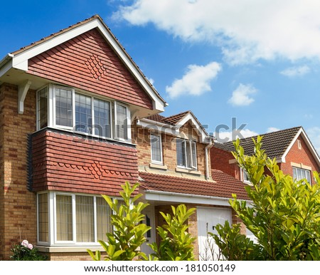 English house on springtime - stock photo