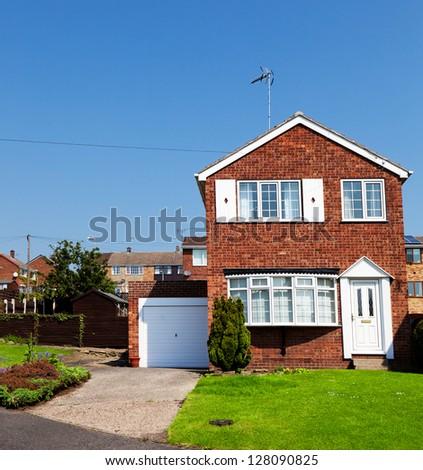English house with garage - stock photo