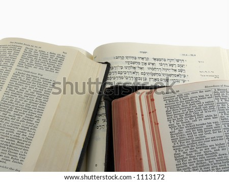 English (KJV), German, and Hebrew Bibles open to Isaiah 55