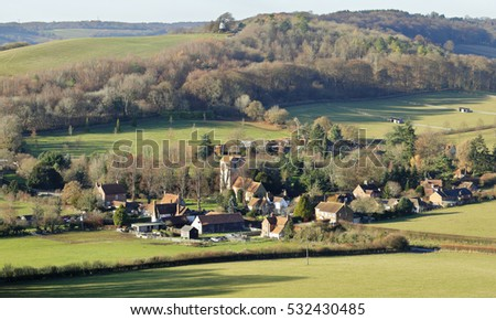 English Landscape overlooking the Hamlet of Fingest  in the Chiltern Hills and windmill on the hill
