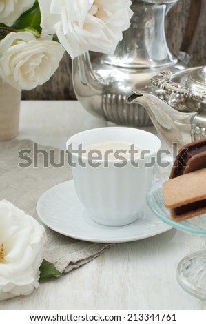 English milk tea and biscuits  - stock photo