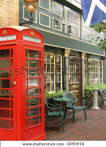 English Pub with exterior red telephone booth - stock photo