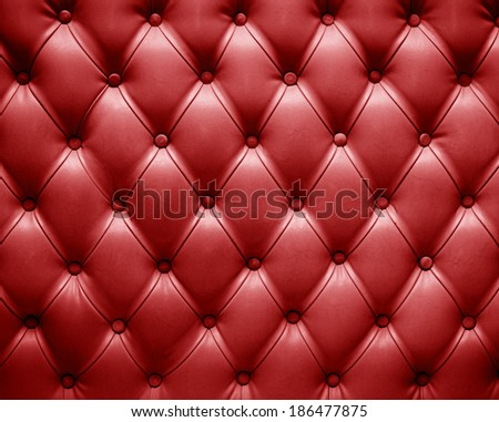 english red genuine leather upholstery, chesterfield style background - stock photo