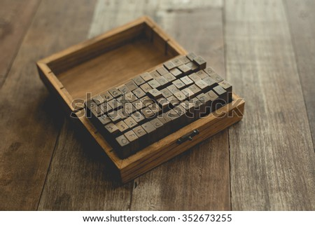 English rubber stamps in wood box. - stock photo