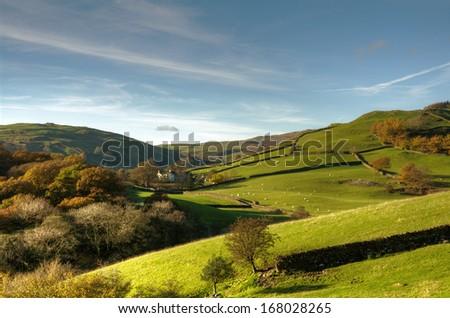 English rural scene with farmhouse - stock photo