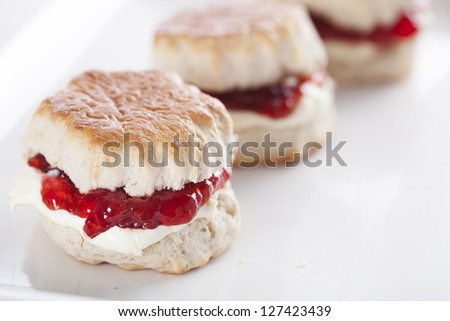 English scones with cream and strawberry jam - stock photo