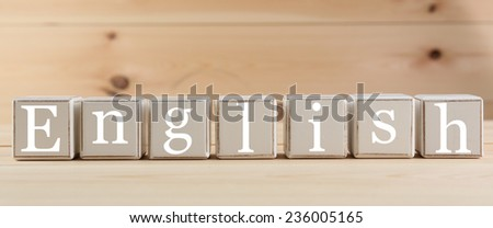 ENGLISH spelled in wooden blocks - stock photo