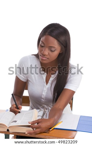 English spelling-bee contest education series - ethnic black female high school student studying dictionary preparing for test, exam or spelling bee contest