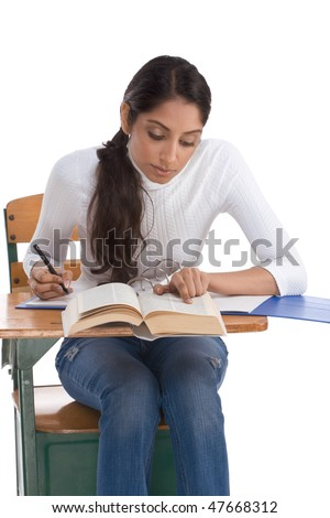 English spelling-bee contest education series - ethnic Indian female high school student studying dictionary preparing for test, exam or spelling bee contest