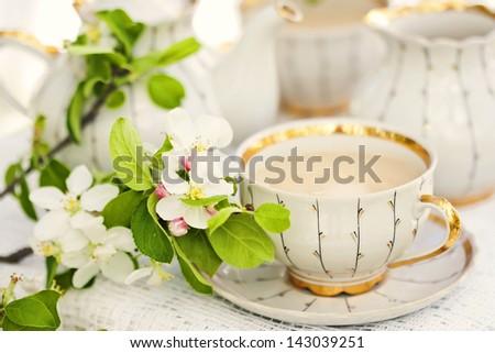 English tea in spring garden - stock photo