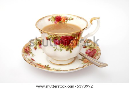 English tea served in Old Country Roses fine bone china teacup with spoon on white background - stock photo