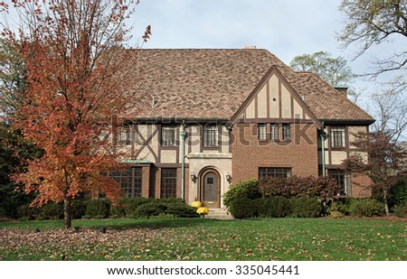 English Tudor Home in Fall - stock photo