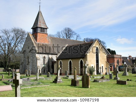 English Village Church and Graveyard with Bell Tower